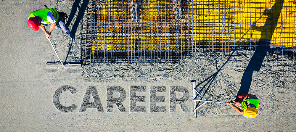 aerial view of concrete foundation with the word career carved in