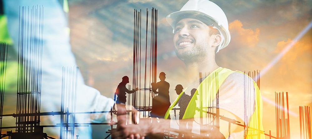 Field manager handshake with an overlay image of a construction site
